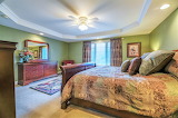 Large bedroom with sleigh bed recessed ceiling