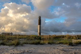 Oak Island Light with the clouds in the background