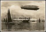 Graf Zeppelin airship & Lufthansa Dornier Do-X Postcard (RPPC).