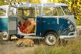 Couple relaxing inside classic van