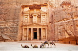 Camels in front of the Treasury carved Petra sandstone Jordan