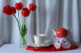 tulips and red teapot still life