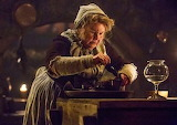 Mrs. Fitz mixes a potion for pain from ground arrow root