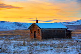 Snow old building west of Arlee Montana