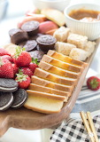 ^ Fondue dessert board