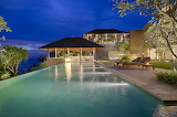 Luxury ocean view villa and pool at night
