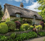 ^ Thatched Cottage, England
