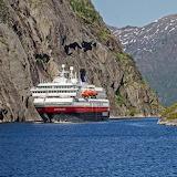 ☺ Sailing round wild cliffs in Norway...