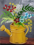 ^ Watering can of wildflowers
