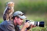 * An inquisitive cheetah by Stu Porter...