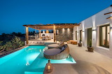 Beautiful villa and pool in Santorini, at night