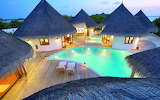 Maldives luxury hotel resort and pool at night