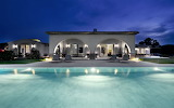 Luxury-design-of-the-home-pool-sun-lounges-with-large-modern-hou