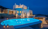 Luxury Greek island villa and pool at night
