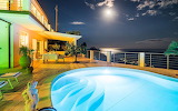 Night scene of sea view villa pool and terrace