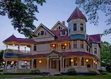 Colorful victorian home at dusk