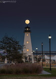 Full moon behind lighthouse Mississippi