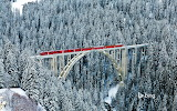 Rhaetain Railway train passing over Langwieser Viaduct. Switzerl