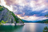 Lake-sky-clouds-cliff