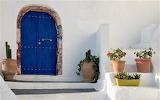 Blue door stone edging santorini greece