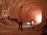 A local guide walks through an opal mine near Coober Pedy, South