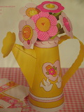 ^ Paper centerpiece watering can and flowers