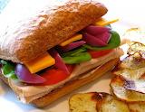 ^ Smoked turkey sandwich with homemade fries