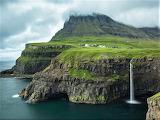 Gásadalur on cliffs under fog Faroe Islands