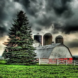 Barn Under Stormy Skies