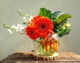 ^ Flower and vegetable arrangement