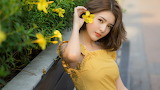 Beautiful asian girl with dress and yellow flowers