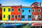21426640-Venice-landmark-Burano-island-canal-colorful-houses-and