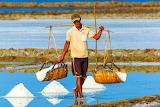 man harvesting salt field