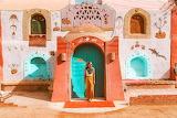 Girl, model, typical house, village, Nile, Egypt, Steve Billman