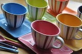 ^ Coffee cups and saucers