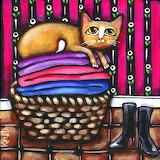 Laundry basket and cat by Krista