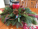 Living Christmas centerpiece with candle