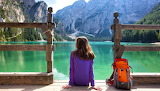 Lake Braies, Dolomites mountains, sitting girl