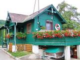 Green wooden chalet
