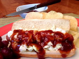 ^ Hot dog with barbecue sauce and slaw