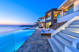 Ocean view luxury villa and pool by night in Crete