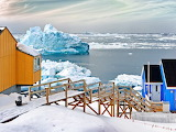 Greenland-colored wooden houses-iceberg-sea-gettyimages