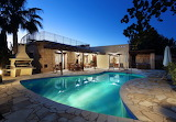 Rustic Mediterranean villa and pool at night