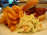 ^ Fried fish sandwich, slaw and fries
