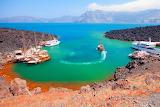 Santorini island-sea-boats-volcano-caldera-rocks-tourism