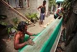 Fishermen building a boat-S