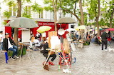 At Place du Tetre, artists and cafes continue to argue during Lo
