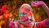 Indian woman dancing in holi festival