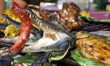 Peru, market food, crocodile head with sausage