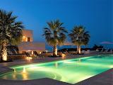 Mediterranean villa, terrace and pool at night